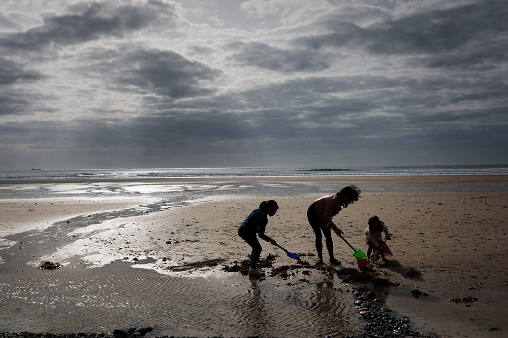 a family photoshoot on St Ouens Bay, Jersey
