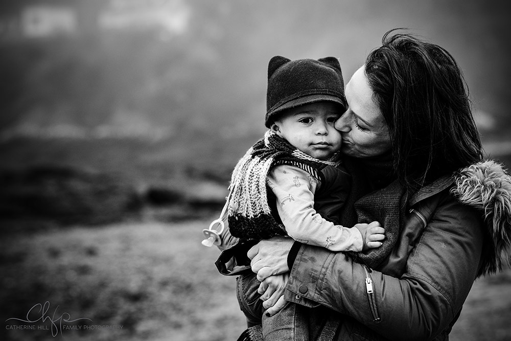mothere and son have a tender moment at their photo shoot at Rozel Bay Jersey